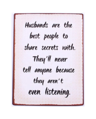 """Metalskilt med tekst. """"Husbands are the best people to share secrets with. They'll never tell anyone because they aren't even listening"""""""