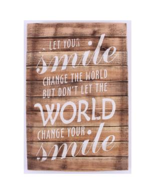 """Træskilt med tekst. """"Let your smile change the world"""