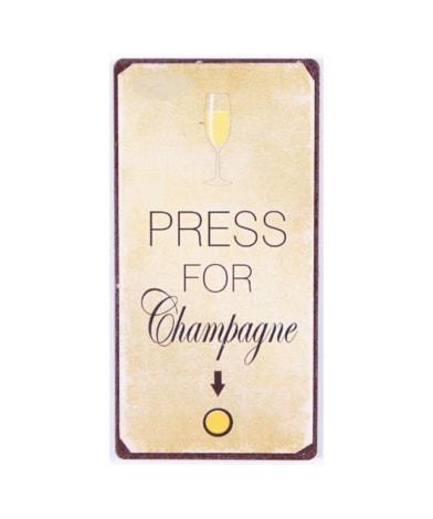 """Magnet med tekst. """"Press for champagne"""""""