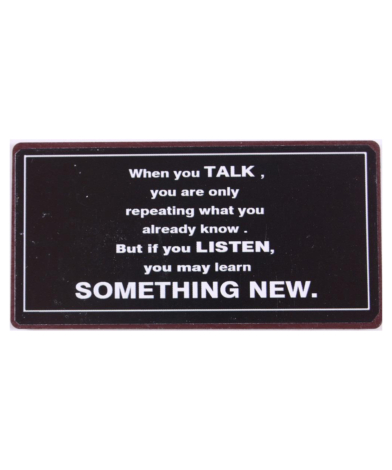 """Magnet med tekst. """"When you TALK you are only repeating what you already know. But if you LISTEN you may learn SOMETHING NEW"""""""